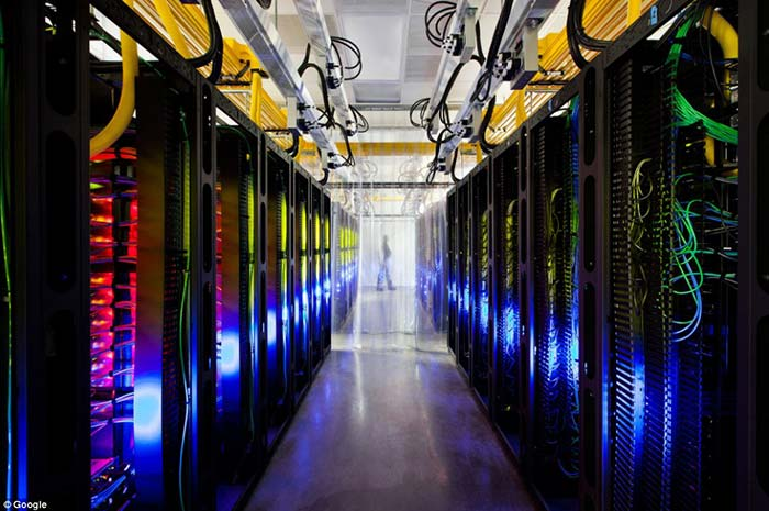 The Iowa campus network room, where routers and switches allow data centers to talk to each other. The fiber cables run along the yellow cable trays near the ceiling.