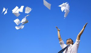 throwing papers in air